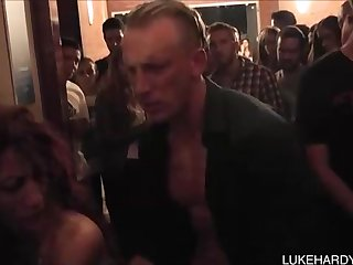 Lengthy haired mummy is spitting on a ultra-kinky stranger's huge spunk-pump, while in the club