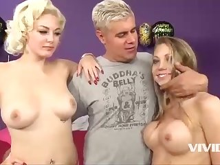 Horny stunners, Jenna and Shawna are spitting on their wild guys' fat implements, while in the sofa