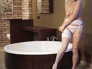 Zealous Sylvie is mature lady who loves to masturbate in the bathroom