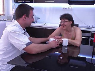 Mature short haired amateur MILF Jacquelin fucks with glasses on