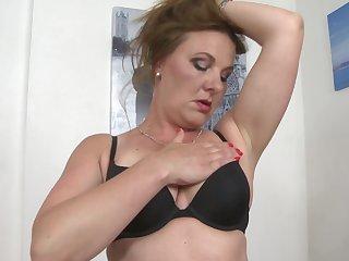 Nasty cougar Ella strips down so she can masturbate alone