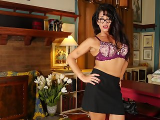 Mature long haired brunette MILF Gabrielle M. strips in the office