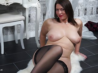 Horny lady Christine O. loves using her fingers to reach orgasm