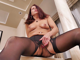 Nyloned milf Candy from Canada needs getting off