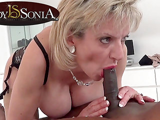 Lady Sonia giving a massage and oral intercourse to a BIG BLACK CHOPPER