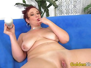 Redheaded Mature Scarlett O Ryan Plays with a Vibrator till Orgasm
