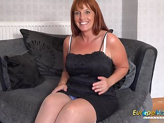 Sexy mature lady only in underwear and nylons is playing with herself alone