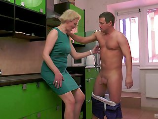 Mature short haired blonde wife Elena pussy pounded in the kitchen