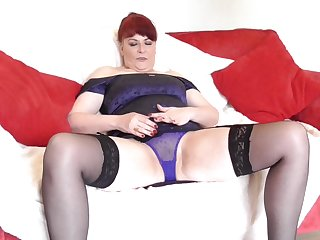 Short haired mature redhead BBW masturbates on the couch