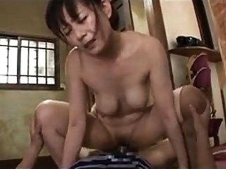 Mature Asian brushes her hairy pussy for dick to fuck her