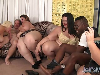 Four cock craving BBWs licking each other during crazy group action